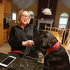 Cornetta quadruplets are graduating from high school. Joanne Cornetta of Westford with the family's one-year-old black Lab, Mason. (SUN/Julia Malakie)
