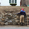"""Gerry Cronin of Westford works on a stone wall in front of his house on Rt. 40. He's been building stone walls since his teens and says he """"just got into it"""" and """"it's very relaxing."""" (SUN/Julia Malakie)"""