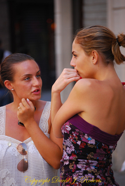 Two young ladies in discussion, Barcelona, Spain