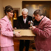 Annual fundraiser at Whistler House art museum. From left, Whistler House president and executive director Sara Bogosian and board members Bob Roach and Joe Pyne, all of Lowell, bring out more wine glasses. (SUN/Julia Malakie)