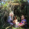 "Grace Bookman, left, Annalise Anderson, and Truth Eamonn, find that the human made hut is a good place to sit.<br /> Simon Harrison teaches a ""primitive skills"" class at Lion's Gulch, outside Pinewood Springs.<br /> For a video and more photos of the program, go to  <a href=""http://www.dailycamera.com"">http://www.dailycamera.com</a>.<br /> Cliff Grassmick / September 16, 2011"