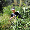 "Brynn Manzella, with Bergen on the back, pulls grass to make a door for a hut the group is finishing up.<br /> Simon Harrison teaches a ""primitive skills"" class at Lion's Gulch, outside Pinewood Springs.<br /> For a video and more photos of the program, go to  <a href=""http://www.dailycamera.com"">http://www.dailycamera.com</a>.<br /> Cliff Grassmick / September 16, 2011"