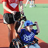 Globe/T. Rob Brown<br /> Trenton Fast, 6, of Jasper, throws his arms up and cheers as he heads toward third base with assistance from Buddy Chanci McGowen of Joplin Tuesday evening, May 7, 2013, at the Will Norton Miracle Field, Joplin Athletic Complex.