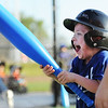 """Globe/T. Rob Brown<br /> Royals runner Paiten Hilton, 5, of Carthage, shows his excitement after scoring a run Tuesday evening, May 7, 2013, at the Will Norton Miracle Field, Joplin Athletic Complex. Hilton ran over to the fence where his father, Ross Collins of Carthage, was watching to share his enthusiasm with Collins. """"He's really excited,"""" Collins said after the game. """"He's here having fun."""""""