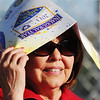 Globe/T. Rob Brown<br /> Marylin Shumake, of Columbus, Kan., holds a Miracle Field Inaugural Year program over her head to keep the sun out of her eyes and off her head as she watched the Royals and Rangers face off Tuesday evening, May 7, 2013, at the Will Norton Miracle Field, Joplin Athletic Complex.