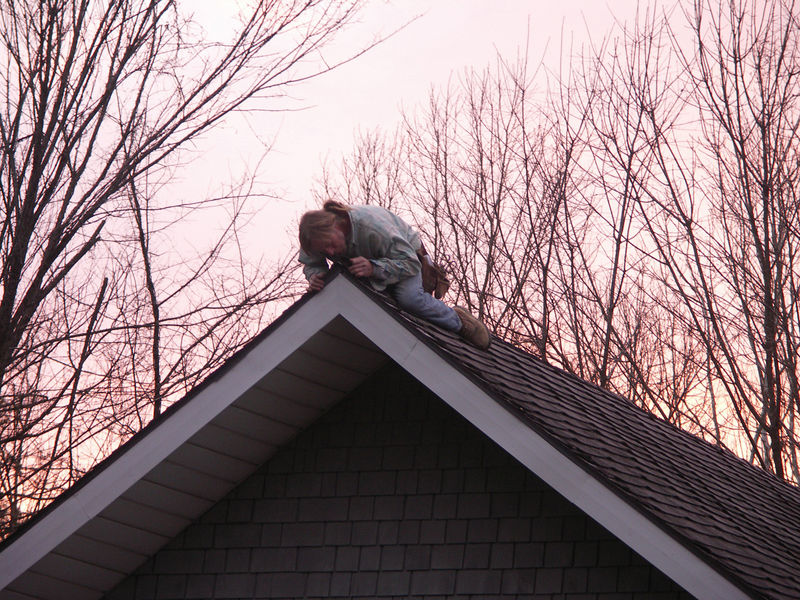 There's Doug Miller up on the roof of Ackerman Hall - before it was our parish house, it was Brown County's one-room schoolhouse.