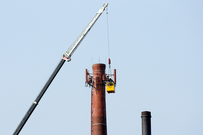 Men are seen working from a crane by a smoke stack at HealthAlliance Hospital Burbank Campus in Fitchburg, Friday afternoon.<br /> SENTINEL & ENTERPRISE / BRETT CRAWFORD