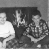 Christmas photo about 1956 in front of Minot house fireplace