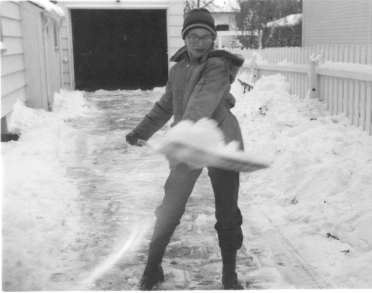 Shovelling snow in the Minot driveway, about 1957