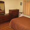 Guest room at our house after hardwood floor refinishing and moving our furniture