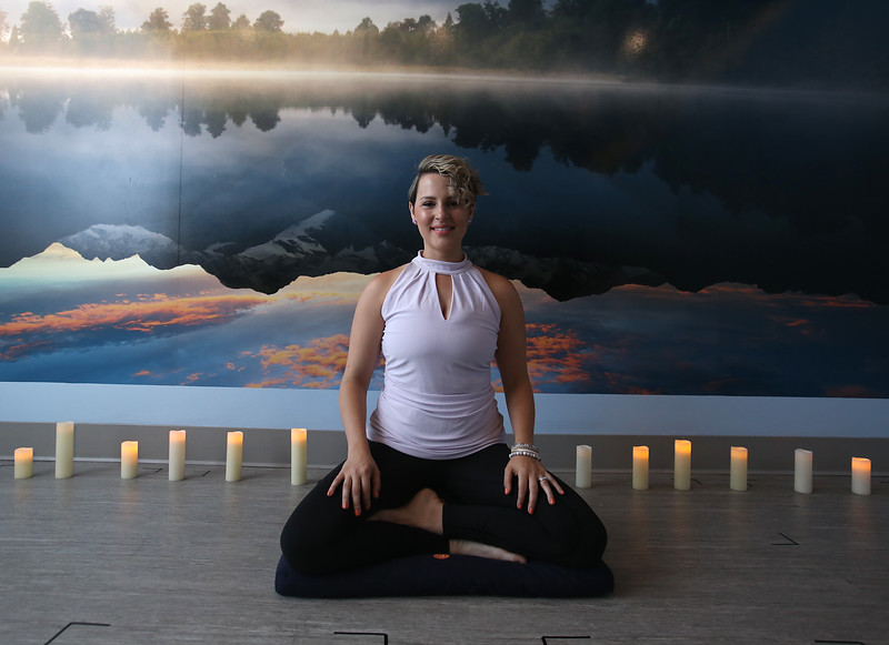 """Yoga instructor Lauren Lopez of Westford, at SoVital Studios in Littleton. Lopez has stage IV (not VI) cervical cancer. SoVital will be holding a """"Sweat to End Cancer"""" event. (SUN/Julia Malakie)"""