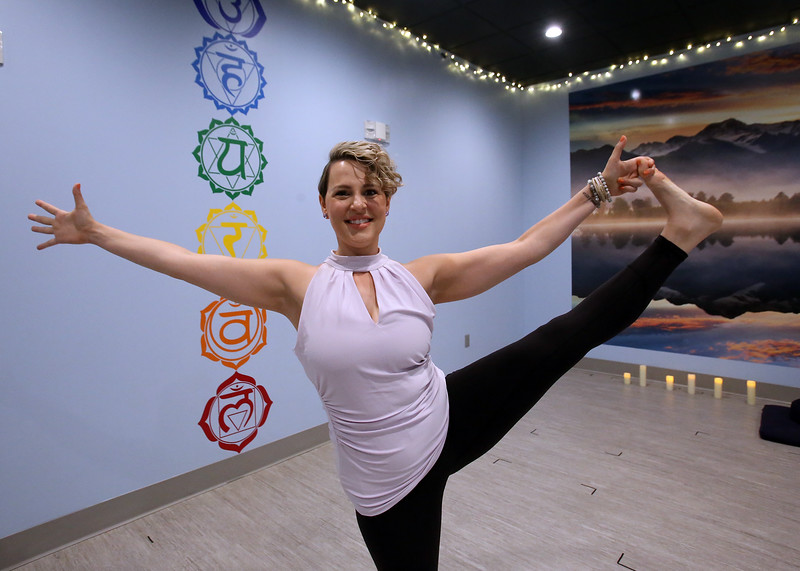 "Yoga instructor Lauren Lopez of Westford, at SoVital Studios in Littleton. Lopez has stage IV (not VI) cervical cancer. SoVital will be holding a ""Sweat to End Cancer"" event. (SUN/Julia Malakie)"