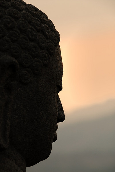 Buddha profile at sunset, Borobudur Temple, Yogyakarta, Central Java, Indonesia.