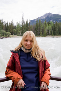 Young woman outdoors - Portrait in front of Athabasca Falls, Canadian Rockies