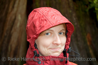 Young Woman with Hood in the Rain - Portrait in Rainforest, Vancouver Island, British Columbia, Canada