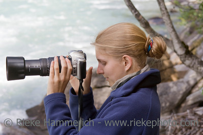 Young photographer with telephoto lens - Fraser River, Rearguard Falls Provincial Park, Canadian Rockies, British Columbia
