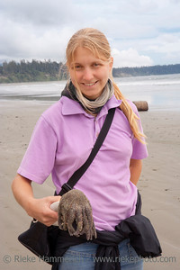Young Woman with dead Sunflower Sea Star - Long Beach, Pacific Rim National Park, Vancouver Island, British Columbia, Canada