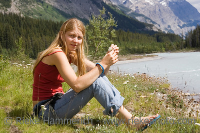 young woman on the river - mistaya river, rocky mountains, canada - adobe RGB