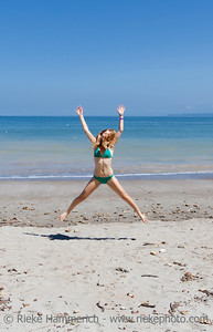 Young woman jumping on the beach - Punta Leona, Costa Rica