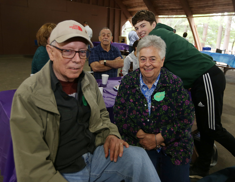. Large family reunion of members of the Young family, at Camp Massapoag. Paul and Phyllis McCarthy of Dracut, and their grandson Jerrick Servente, 16, of Dracut. Phyllis is a granddaughter of Peter and Delia Young. (SUN/Julia Malakie)