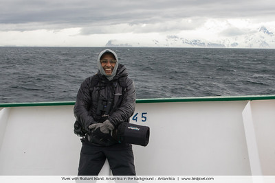 Vivek with Brabant Island, Antarctica in the background - Antarctica