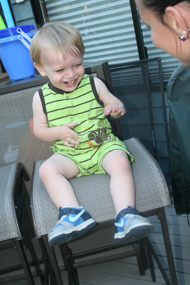 Zane giggling with Auntie Michelle - 19 mo old Jul 2010
