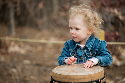 Girl playing the bongo