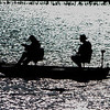 A Silhouette of Fishermen on a Boat on Manasquan Reservoir