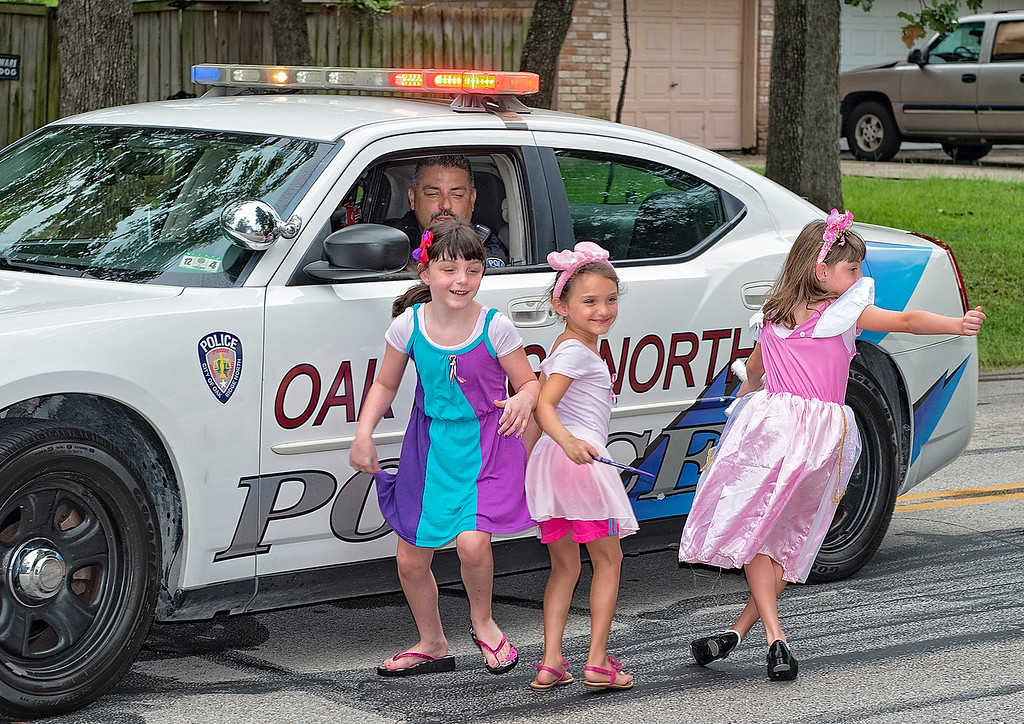 Kids on the run after getting some treats in a July 4th parade..