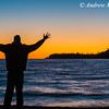 Silhouette of Adult Male at sunset on Lake Superior in Lake Superior Provincial Park, Ontario, Canada