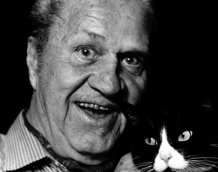 Jazz Cornetist Jimmy McPartland and his cat Blackie in Merrick, New York