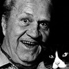 Jazz Cornetist Jimmy McPartland and his cat Blackie in Merrick, New York