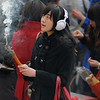 Worshipper at Yonghegong, Beijing during Chinese New Year 2010