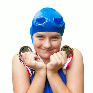 Happy girl in bathing cap with two swimming medals