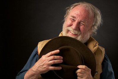 Portrait of smiling senior man holding his hat