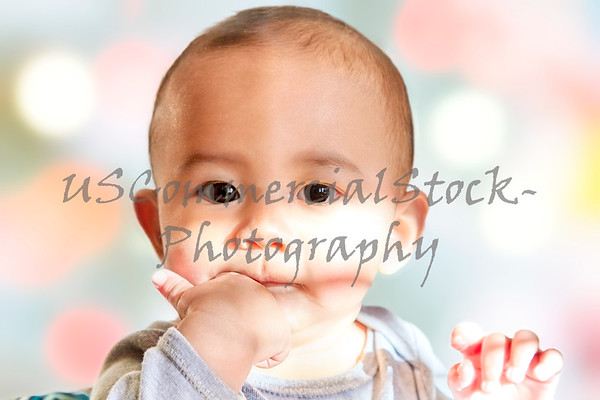 Baby boy with Hand in mouth