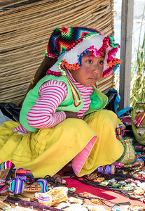 Uros Girl with her toys - Lake Titicaca, Peru