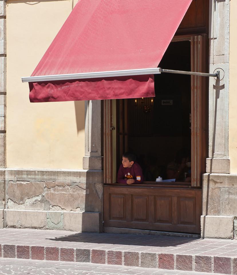 Boy in WIndow Guanajuato Mexico