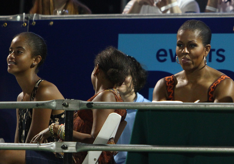 Mrs Obama sticks out her tongue, elegantly and discreetly.