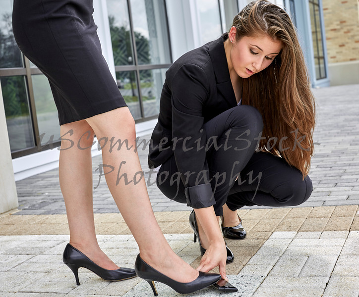 Woman bending to pick up Cell Phone before it is Stepped On