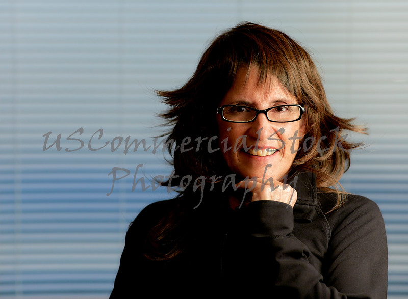 Middle Aged Woman with Brown Hair wearing Eyeglasses