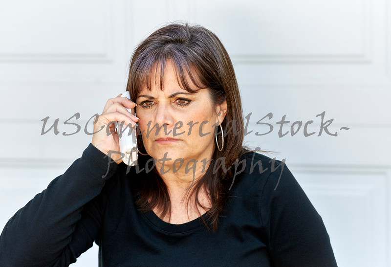 Middle Aged Woman with an angry  Expression while on the Phone