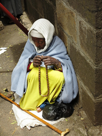 Woman Praying With Beads at St. George Ethiopian Orthodox Church in Addis Ababa