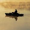 A Fisherman on a foggy Manasquan Reservoir at Sunrise
