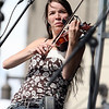 Fiddler, woman on stage at a folk festival