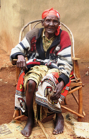 Old Woman Preparing Grain in Alego, Kenya