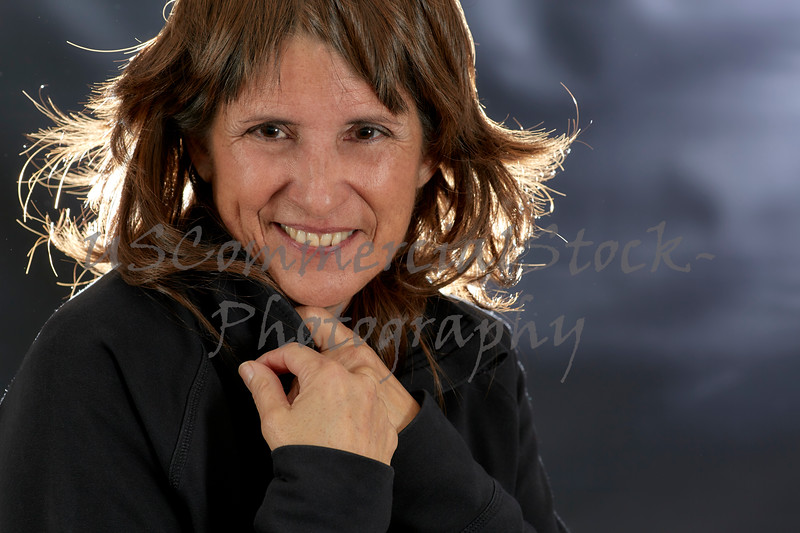 Woman with Brown Hair resting Chin on Hand