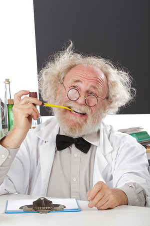 Eccentric scientist in lab thinks of ideas