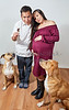Pregnant Woman and a Man with Two Dogs