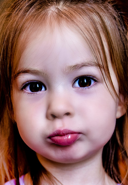 A cute two-year old puts on her serious face